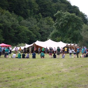 large circle of people at a woodcraft folk AGM in a field