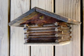 log cabin style blue bird house