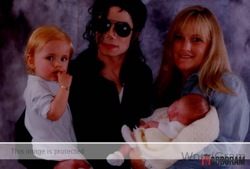 Michael Jackson And Debbie Rowe With Her Children