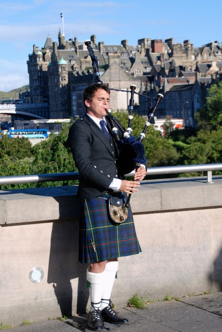 Traditional Highland bagpipe player
