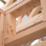 Timber frame house under construction. looking up through wooden frame to sky