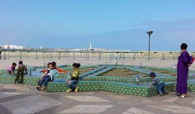 children playing around a fountain