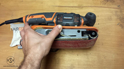 how to change sandpaper on a belt sander