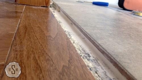Install Custom Threshold 1, Master Bath Remodel, Flooring