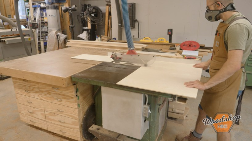 cross cutting plywood on a tablesaw