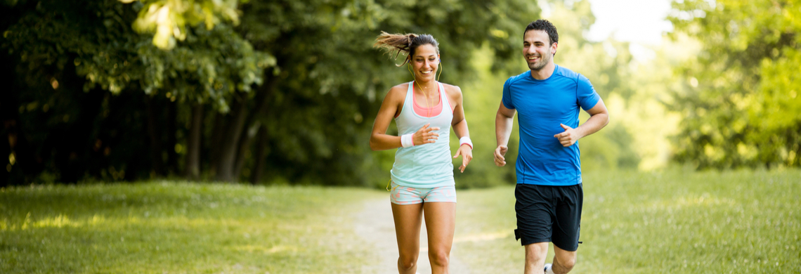 Couple running outside