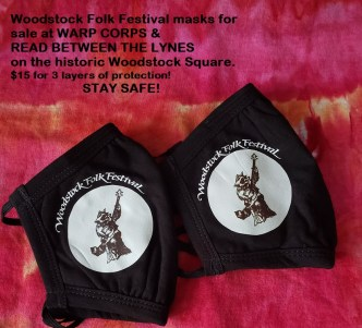 We now have Woodstock Folk Festival masks for sale at WARP CORPS & READ BETWEEN THE LYNES on the historic Woodstock Square.