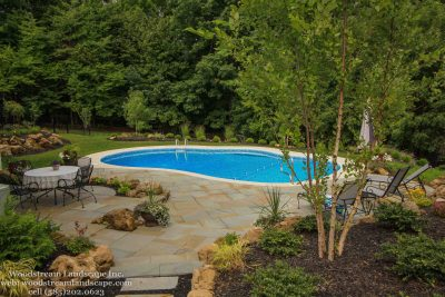Boulders used to install an inground pool on a sloped yard Penfield NY