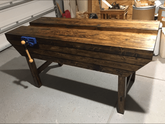 """Used 2X4's from the local big box store. Bench is 33""""w X 78""""l X 39""""h. Finished with a walnut stain and several coats of shellac. Added quick release vise. Inspired from Paul's 11 part YouTube video series from 4 years ago. Can't say enough about how great of an experience it was to hand chop the mortise holes as well as using a hand plane. You really do get a feel for how will respond and when to plane in a different direction depending on the resistance you feel. I wish I took that into consideration more before I glued everything up as a group....at least I think it may have helped some."""