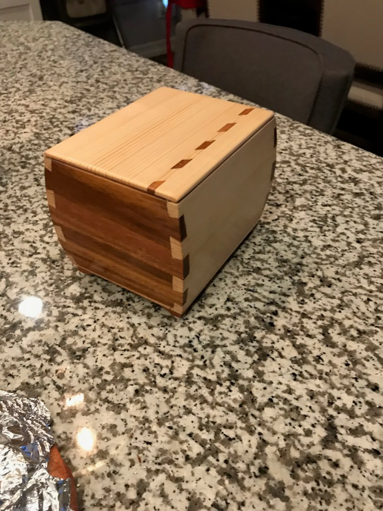 Pine/Sapele w/ geometric inlay. No lid. Will never open. Pet urn box for friend.