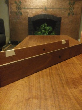 """Mahogany with walnut and maple. I wish my walnut strip contrasted a little better with the mahogany, but overall I'm amazed at how these turned out. They're my first """"real"""" project, and I'm excited to use them for years to come. I'm laughing though that what took Mr. Sellers an hour to make took me all day!"""