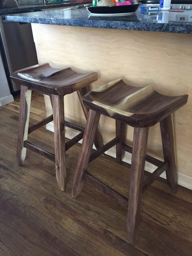 Walnut, the seats are different sizes for my wife and me.
