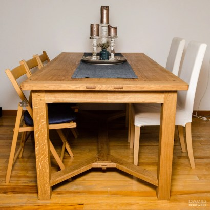 an oak dining table with breadboard ends and Y-stretchers