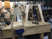 Pair of sawhorses made from 4x2, 3x2 and 6x1 pine. Standing on the bench I made based on Paul's design. One needs a little surface planing once the glue has dried. Many thanks.