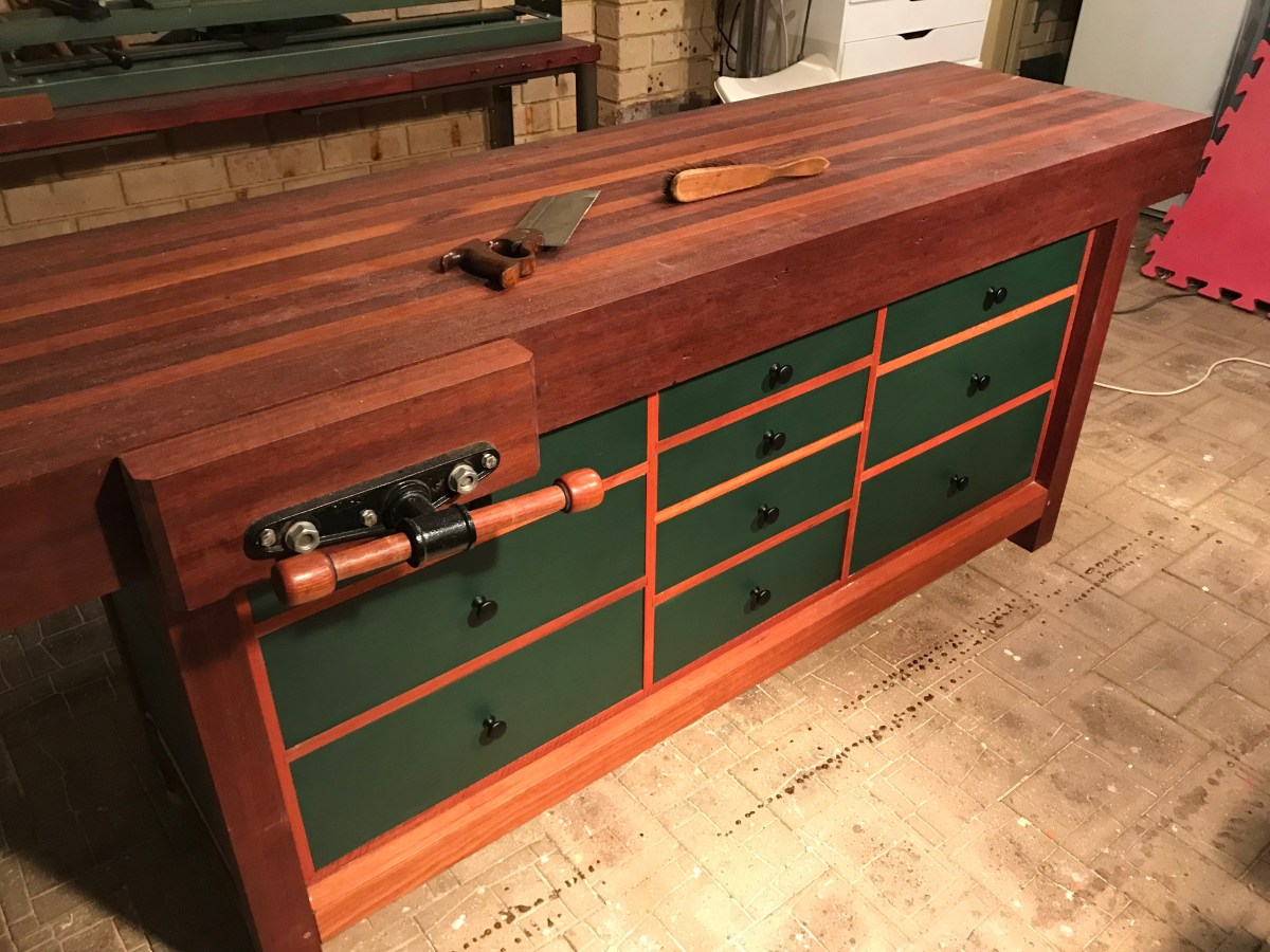 Australian Karri (E. diversicolour) salvaged from a home demolition. Store bought Pine for the drawers and drawer frame with Jarrah (E. marginata) for the face frame. Mortise and tenon joints pinned with Tasmanian Oak dowels. 2100(L)x600(w)