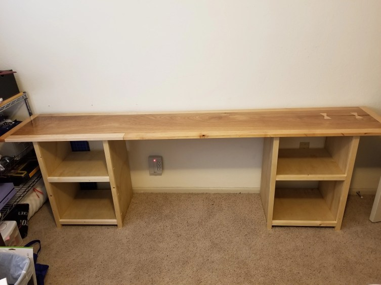 a crafting table i built for my wife. oak and elm top, plywood cabinets.