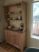 Kitchen hutch incorporates methods from Paul's bookcase project (layout, joinery, bullnosing, door fitting, etc). Uses alder and mahogany for door panels and countertop.