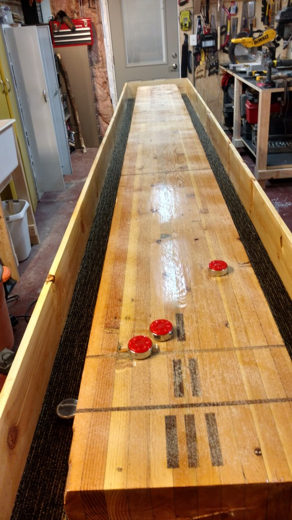Shuffleboard table built from a reclaimed park shelter beam and pine.