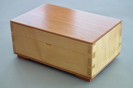 Variation on a Theme. Keepsake box in Sycamore and American Cherry without the curves made for our 6 month old grandson. Finished exactly the same as Paul's box: shellac and furniture polish. All wood hand prepared/planed.