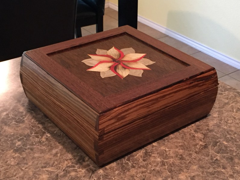 Zebra wood sides and wenge frame and panel top and bottom.