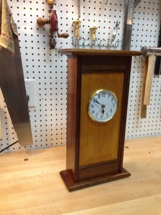 walnut and maple with garnet shellac then wax; my 4th clock