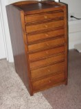 Cabinet to hold wife's sewing machine accessories and supplies. White Oak, stained and glazed with waterborne finish.