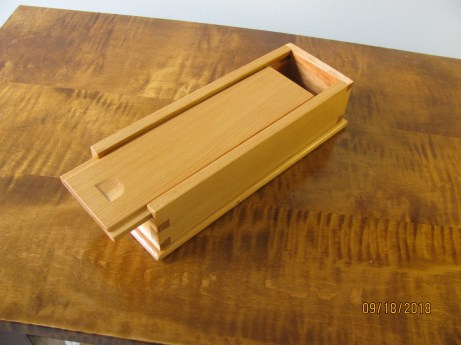 Small Sliding Lid box, made from old wood from toolbox till. Note nail hole in bottom. Wood seems to be spruce or white pine.