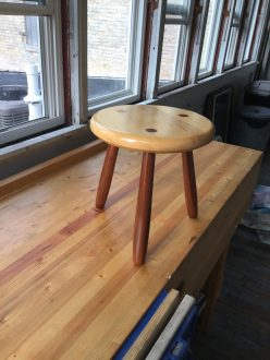 Milking Stool. My first project on my Seller's-style workbench! Thanks woodworkingmasterclass crew! Pine and redwood. Shellac and furniture polish finish.