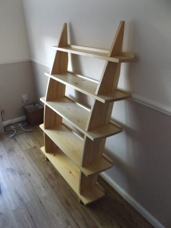 Leaning Wall Shelf in Builders Pine - two-thirds size. Unfortunately there is a dado rail in the way. I may recess the backstops as in the top shelf.