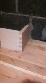This is the corner of a half-blind dovetail made from pine. I'm making four drawers with half-blinds. In preparation, I've been practicing with cut-offs from past projects.