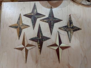 A few stars made for Christmas presents, Spalted Maple, Walnut, Red Oak, White Oak, Elm and Cherry woods