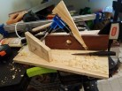 This is the first plane I've made. The wedge is ugly, the chisel is rusty, but boy does it work! I used a section of an old wooden level as the plane body, not sure of the wood. Maybe rosewood? Also pictured is the poor man's router used in the project. Thanks so much to WWMC team for putting such great info out there!