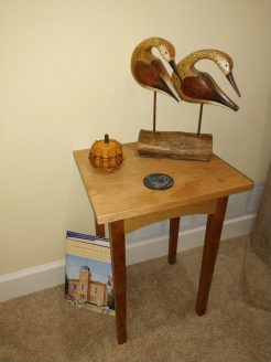 End table in cherry. Finished with Danish oil and wax. Shore birds carved by my grandfather.