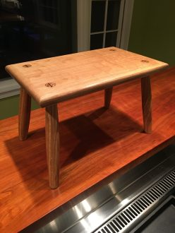 Foot stool made using Paul seller's design and technique, quarter-sawn white oak from Kentucky with ebony wedges from Africa.