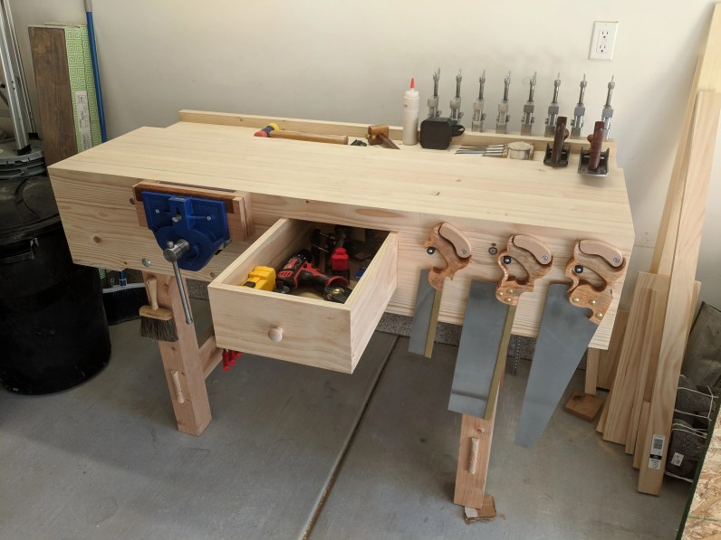 Laminated 2x3 for top and aprons, 4x4 and 2x6 for the legs, laminated 1x6 for the well board, and 3/4 pine for drawers.