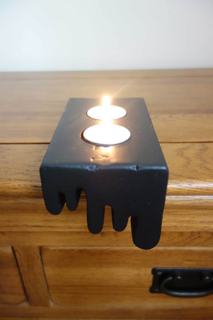 Melting tealight holder