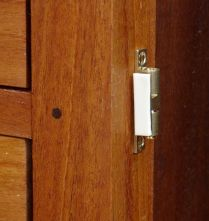 Double back tape to locate catch on door