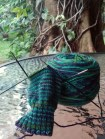 Knitting my sock next to a gigantic tree.