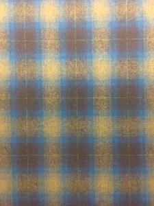 swatch of Pendleton wool fabric in a yellow, blue and taupe plaid.