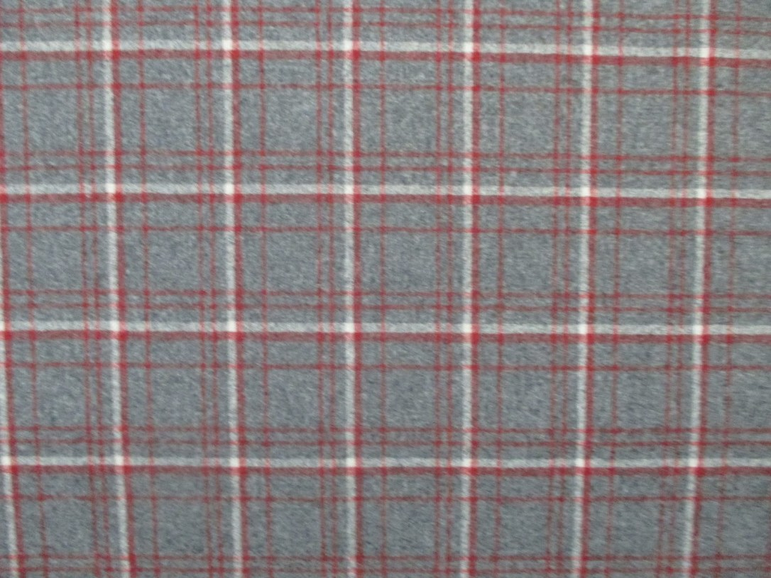 swatch of Pendleton wool fabric with a plaid of red and white on a grey background.