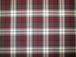 Swatch of Pendleton wool fabric in MacDonald Tartan, which is a tartan plaid of white, red, black and frey.