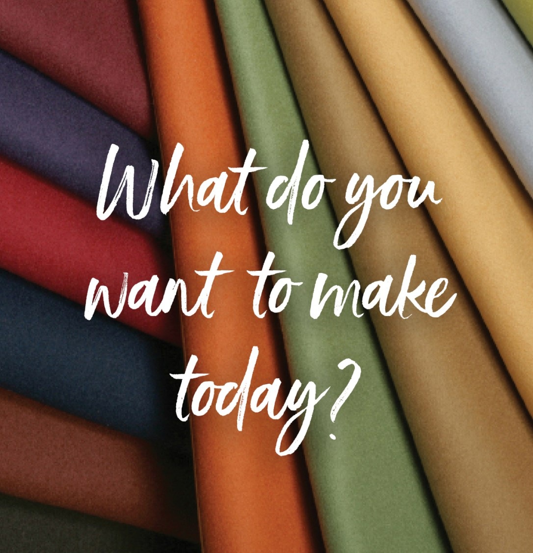 "folded pieces of Pendleton Eco-Wise Wool with the words ""What do you want to make today?"" over them"