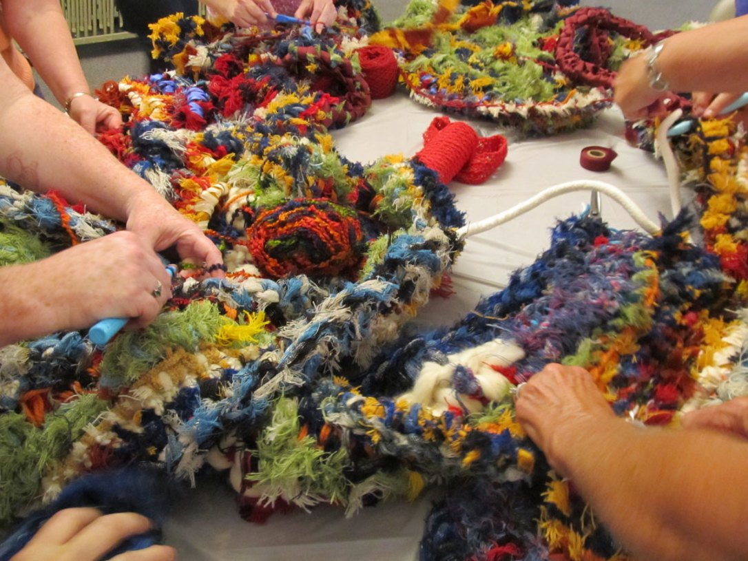 Crocheters work on a group project made of Pendleton wool scraps.