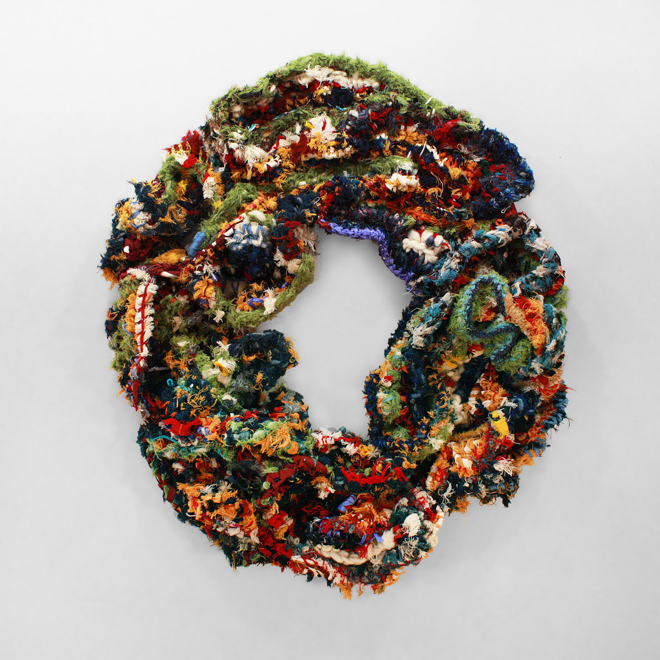 a finished gigantic freeform crocheted wreath, made at a workshop led by Bonnie Melzer from Pendleton wool scraps.