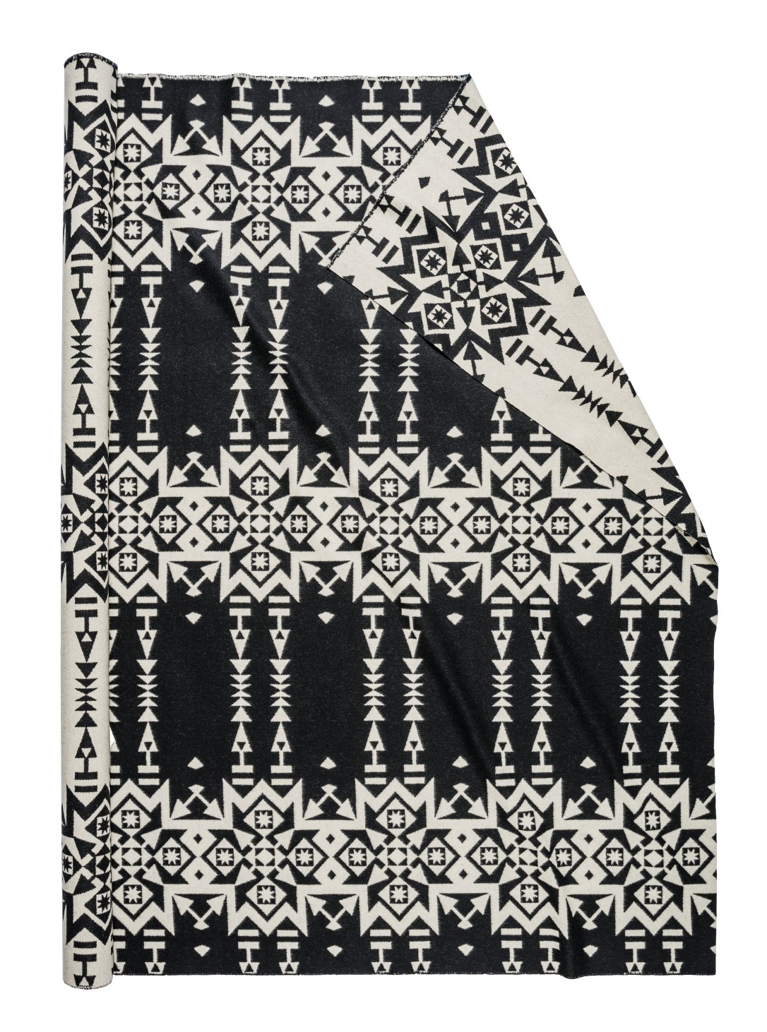A roll of Pendleton fabric in Condensed White, with a black background and pattern of white stars and arrow chains.
