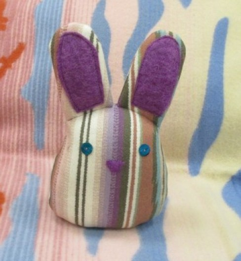 front view of stuffed toy rabbit made with striped Pendleton wool fabric