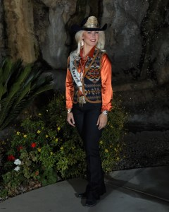 Miss Rodeo Oregon, Taylor Ann Skramstad, poses in jeans, an orange satin shirt, and a vest made with Pendleton wool .