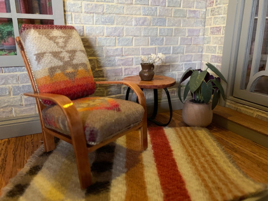 A dollhouse chair upholstered in Pendleton wool