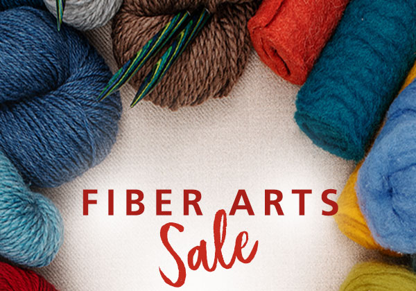 """A grouping of wool yarn in various colors, with the words """"Fiber Arts Sale"""""""