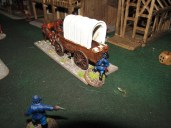 Buffalo Soldiers trying to stop their run-away wagon containing their gatling gun.